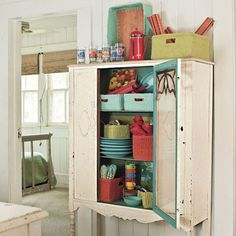 Add Vintage Storage Space | Not enough built-ins? Use vintage cabinets or hutches for added storage.