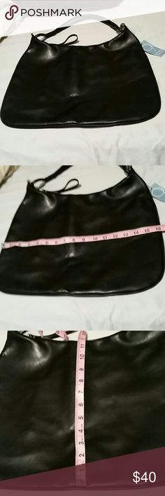 1DAY SALE NWT BEAUTIFUL NINE WEST PURSE Was $50 now $30 This beautiful purse is in excellent condition never been used.  100 % leather . It does have some natural scaring in the top grade cowhide . Lots of room inside.11.5 × 16 inches.  Strap Approximately 19 inches. Nine West Bags Shoulder Bags