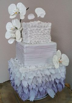 Purple ombre sugar feathers wedding cake with gumpaste moth orchids by Megan Joy Cakes