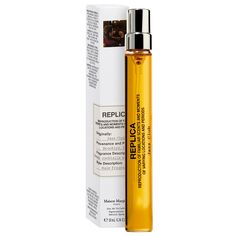 MAISON MARTIN MARGIELA's 'REPLICA' Jazz Club Travel Spray at Sephora. This scent evokes the memory of a hidden jazz club with tobacco and vanilla notes.