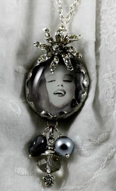 Sparkly Marilyn Monroe pendant. This jewelry art piece was created by attaching a printed picture to a clear glass bauble. I soldered