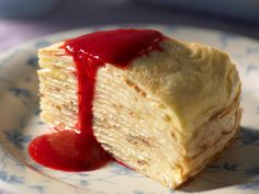 This beautifully light cake make from layered crepes and a rich lemon cream filling is absolutely beautiful served sliced with a drizzle of fresh, sweet raspberry sauce as a gorgeous dessert.