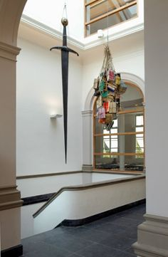 Ni Haifeng (artist): 'Equilibrium', symbolising the balance between legal   practice (the sword) and academic doctrine (the books)