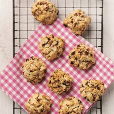 Low calorie cranberry rock cakes on a baking tray with a red and white tea towel