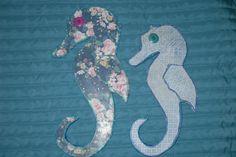 Cavalo-marinhos reciclagem de papelão