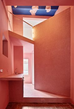 In his Barcelona home, Guillermo Santomàused vibrant shadesof green, pink, and blue to delineate space and create a beautifully saturated backdrop.
