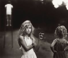 One of my favorites from Sally Mann.  Although I have issue with most of the work Mann does, I find this image curious.  Boy on stilts, young girl with cigarette facing camera, while little sister, hands on hips, watches brother.  A circus of oddity?