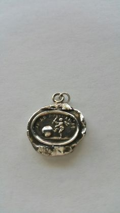 7 best pyrrha pendants images on pinterest pendant pendants and love moves the world this french seal reads je le bouge meaning love moves the aloadofball Choice Image