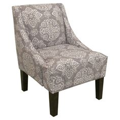 Foam-cushioned swoop arm chair with medallion-print upholstery and a pine wood frame. Handmade in the USA Product: Chair