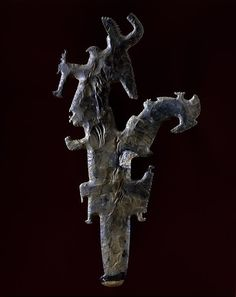 Scepter with Profile Figures. Maya, 7th–8th century. Medium: Flint. H. 13 5/8 x W. 7 1/2 x D. 5/8 in. (34.6 x 19.1 x 1.6 cm). Guatemala, Mesoamerica. Maya artists skillfully chipped flint, a fragile and challenging medium, into imaginative multifigure and geometric shapes. The worked flints are frequently found as offerings in Maya tombs. This eccentric flint depicts, in profile, two figures wearing headdresses. Rockefeller Gift, 1967. -The Metropolitan Museum-