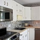 We flipped a ranch and took this kitchen from drab to fab. With dark cabinets, broken doors, faux brick laminate floors and the washer and dryer connectio… Dark Cabinets, Kitchen Cabinets, Kitchen Appliances, Grey Kitchen Designs, 1960s Kitchen, Grey Palette, Faux Brick, Countertops, Kitchens