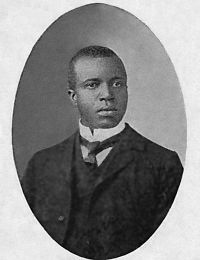 """Scott Joplin was a composer & pianist. During his brief career, Joplin wrote 44 original ragtime pieces, 1 ragtime ballet, and 2 operas. His most notable work of classical music was """"The Maple Leaf Rag"""" released in 1899 which became ragtime's first & most influential hit. Throughout his music career, he became The King of Ragtime having knowledge of playing the banjo, piano, & violin."""
