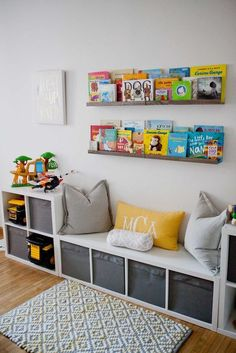 IKEA storage is king in this play room. The book rail displays colorful and beloved children's books in the kids' playroom. IKEA storage is king in this play room. The book rail displays colorful and beloved children's books in the kids' playroom. Toy Rooms, Room Ideas Bedroom, Book Corner Ideas Bedroom, Bedroom Wall, Master Bedroom, Ikea Bedroom, Bed Wall, Bedroom Flooring, Bedroom Themes
