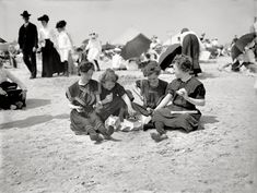 """Coney Island, New York, circa 1905. """"Picnicing on the beach -- a hasty lunch."""""""