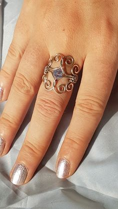 elegant sterling silver wire ring with swarovski bead.