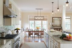 white kitchen with breakfast room--love the chairs!
