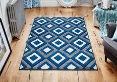 Viva Geometric Rug is a perfect way to add both style and value to your décor. #bluerugs #geometricrugs #largerugs #designerrugs