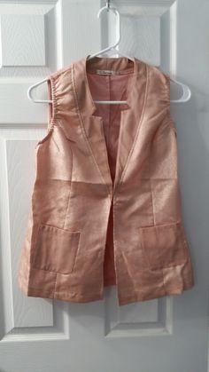 Carmin light pink sparkly vest.  NWOT.  Size L but runs small.  $10