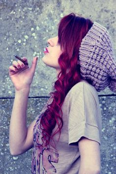 Smoking is not cool but I love her hair, hair color, and hat