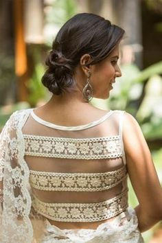 Buy House Of Blouse Off-white threadwork sleeveless blouse with net and lace sheer back online in India at best price.Meet those summer weddings head on with this white lace blouse. The threadwork against the bold and detailed Blouse Back Neck Designs, Silk Saree Blouse Designs, Choli Designs, Fancy Blouse Designs, Kurta Designs, Blouse Designs Catalogue, House Of Blouse, Designer Blouse Patterns, Skirt Patterns