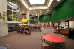 Science Hall Elementary School | Claycomb Associates, Architects- love that you can see into it from stairs, great computer area, nice use of curve and color