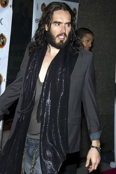 Russell Brand has been named in a police report in New Orleans by a paparazzo who claims the actor snatched his cell phone out of his hand and fired it through the window of a nearby building, the website TMZ is reporting. The photographer told police he was shooting Brand with his phone from a car on Monday when the actor wrestled the phone out of his hand.  Brand was in town shooting Paradise.