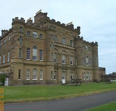 Culzean Castle is a castle near Maybole, Carrick, on the Ayrshire coast of Scotland. It is the former home of the Marquess of Ailsa, the chief of Clan Kennedy, but is now owned by the National Trust for Scotland. The clifftop castle lies within the Culzean Castle Country Park and is opened to the public. Since 1987, an illustration of the castle has featured on the reverse side of five pound notes issued by the Royal Bank of Scotland.
