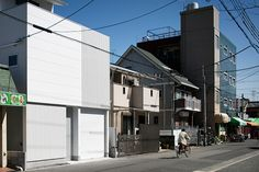 in the japanese city of osaka, architect yoshiaki yamashita has completed 'light grain', a three storey dwelling that features a perforated façade. Three Story House, Osaka Japan, Japanese House, Interior Architecture, Facade, Grains, Street View, Gallery, Pictures