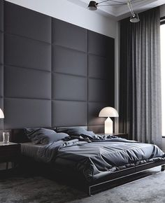 Large modern and masculine master bedroom. Dark grey wall mounted upholstered headboard.