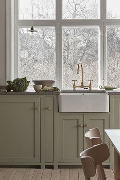 Nordiska Kök - The Classic Shaker kitchen is the natural heart of this beautiful home. Handmade in our carpentry in Gothenburg and handpainted in a pale sage green color, with a limestone countertop. More kitchen inspiration visit www. Shaker Style Kitchens, Shaker Kitchen, Kitchen And Bath, Home Kitchens, Nordic Kitchen, Rustic Kitchen, Kitchen Decor, Kitchen Dining, Country Kitchen