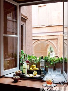 The walls of this apartment in Rome are almost three feet thick, which means the windowsill is large enough to serve as a bar during parties.