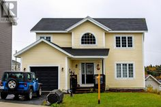 41 BRITTANY Drive Paradise Newfoundland  (1126094) | Located in a quiet, family friendly subdivision Woodstock Gardens is this Beautiful 2 storey home with a large attached garage. Buy now! For more info contact Wally Lane (709) 764-3363 wally@normanlane.ca