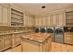 Huge laundry room. Center island with sink, tons of counter and cabinet space.