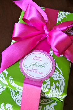 Wrap and stack collection of gifts then tie with a single brightly colored ribbon. #giftwrap #ribbon #pinkgreen