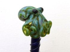 Hey, I found this really awesome Etsy listing at https://www.etsy.com/listing/71770583/mossy-green-glass-octopus-hairstick