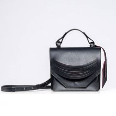 Mini Extreme Slashed Bag in smooth black with rows of red contoured wrist straps ■Available online    #aw17 #aw1718 #collection #black #red #handmade #leather #leatherwork #minibag #microbag  #lindasieto Black Italians, Leather Bags Handmade, Leather Shoulder Bag, Shoulder Bags, Aw17, Mini Bag, Italian Leather, Leather Working, The Row