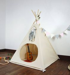 Beautiful indoor play teepee, great for girls or boys. The teepee was handcrafted with utmost care and quality materials. 100% cotton Dimensions are: 180CM (71) High of poles. 110CM (43) Side of the base. 110x110cm ( 43) Carpet. Whats included: - fabric teepee tent with window - wooden