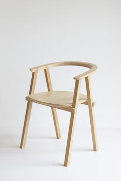 A minimalist design by Oato for Kuperus & Gardenier, and the chair is made from oak wood and was inspired by stacked beam structures used in many cultures.