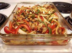 Healthy oven baked fajitas  1 pound boneless, skinless chicken breasts, cut into strips 2 Tbsp vegetable oil 2 tsp chili powder 1 1/2 tsp cumin 1/2 tsp garlic powder 1/2 tsp dried oregano 1/4 tsp seasoned salt 1 (15 oz) can diced tomatoes with green chilies (Rotel) 1 medium onion, sliced 1/2 red bell pepper, cut into strips 1/2 green bell pepper, cut into strips