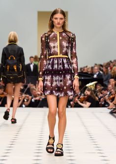 Purple black tie-dye print tulle dress with regimental goldwork taping. Discover the collection at Burberry.com