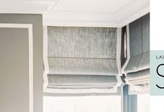 window treament  Roman shade with trim tape - hung under crown molding