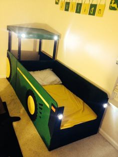 John Deere Tractor Bed I built for my 18 month old! He loves it!!!