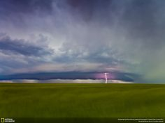 A supercell thunderstorm roars over wheat fields near Oshkosh, Nebraska on June 16, 2011. The photo was captured after a long storm season that started in April. I wanted one photograph from the 2011 storm season that displayed the incredible beauty and power of a Great Plains supercell. I believe I captured that moment with this photograph by allowing the shutter to stay open for 10 seconds. The effect of the inflow winds on the wheat field and movement, along with the lightning and cloud…