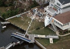 SEA BRIGHT, NJ - OCTOBER 31: Boats are strewn among houses amid wreckage from Superstorm Sandy on October 31, 2012 in Sea Bright, New Jersey. At least 50 people were reportedly killed in the U.S. by Sandy with New Jersey suffering massive damage and power outages. Photo: Mario Tama, Getty Images / 2012 Getty Images