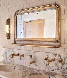 vintage mirror, gold fixtures, marble sink, white subway tiles