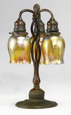 TIFFANY STUDIOS THREE-LIGHT TABLE LAMP | Sotheby's