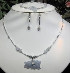 MYSTIQUE: Blue Lace Agate Flower Pendant W/ Chips in Silver 3 piece set (Handmade)    Manufacturer: N/A  SKU: CLC193  Price: $45.00  This item is in stock