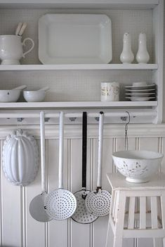 White on white. We love a kitchen where a colander gets its own stool  elly roselly - kitchen
