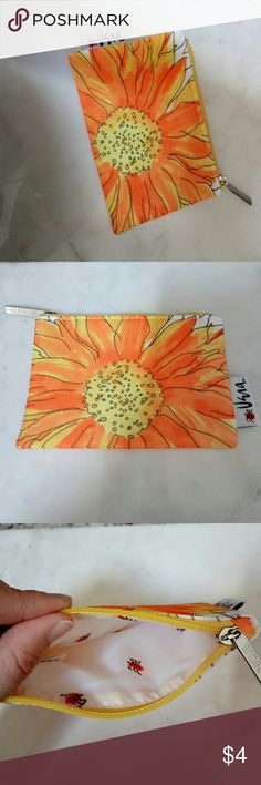 Sunflower wallet / coin purse So bright & pretty! Sunflower zippered pouch with cute bugs on the inner lining. NWOT.  This adorable item is a great option if u want to bundle and save! Clinique Bags Wallets