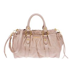 PALE PINK Cod. - Shiny calf top handle bag with laces on front  Gathering on top part and laces on sides  Polished brass hardware  Detachable shoulder strap  Snap closure  Inside pocket with zipper  Metal lettering logo on outside  Cotton satin lining  Strap lengt